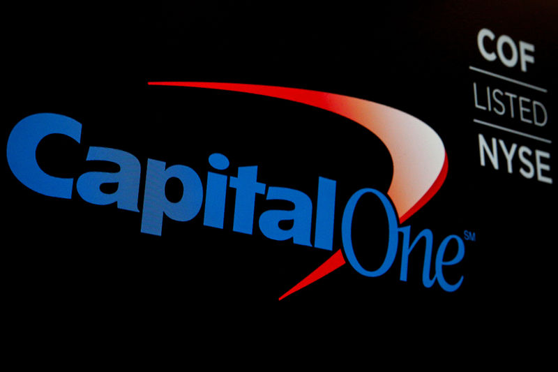 © Reuters. The logo and ticker for Capital One are displayed on a screen on the floor of the NYSE in New York