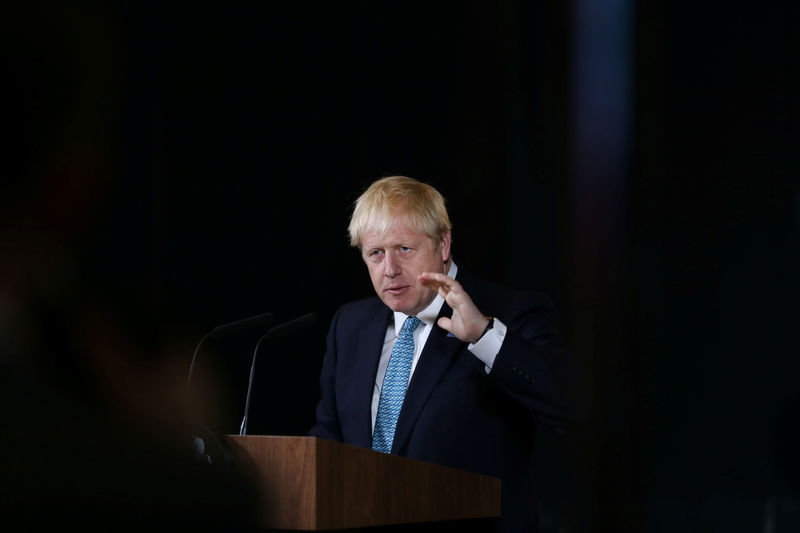 © Reuters. FILE PHOTO: Britain's Prime Minister Boris Johnson gestures during a speech on domestic priorities at the Science and Industry Museum in Manchester