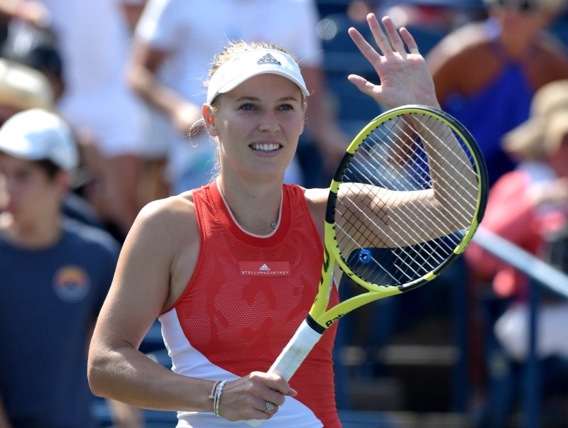 Former champs Wozniacki, Bencic advance at Rogers Cup