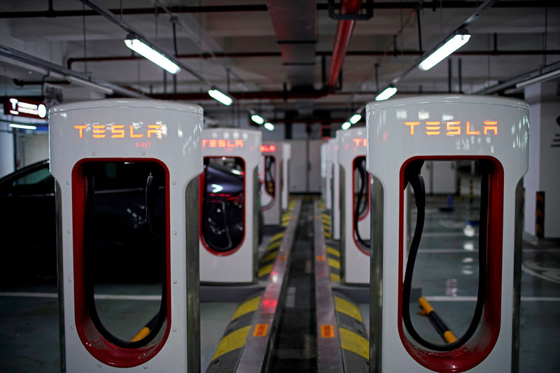 © Reuters. FILE PHOTO: Tesla Superchargers are pictured in a parking lot in Suzhou