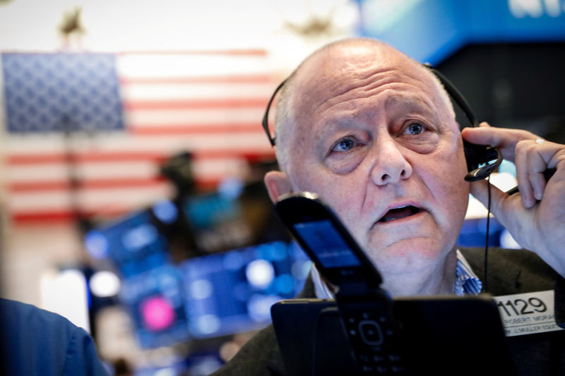 Wall Street ends lower amid more trade fears, high volatility