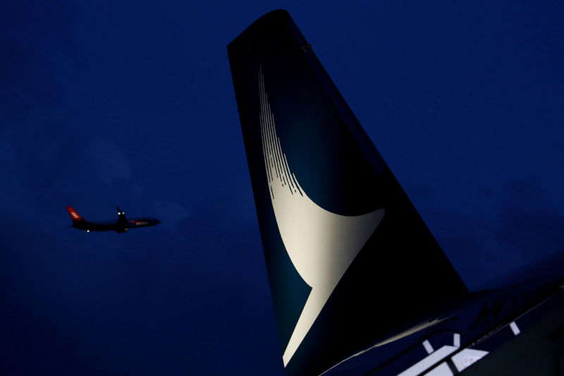 © Reuters. FILE PHOTO: Plane flies behind a new Cathay Pacific Airways Airbus A350 after being received by the airline at Hong Kong