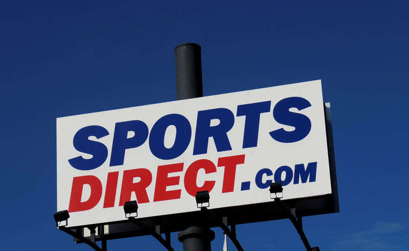 © Reuters. FILE PHOTO: Company logo is seen outside a Sports Direct store in Vienna