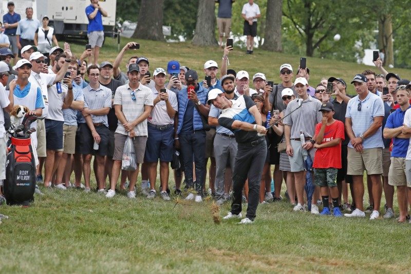 History repeats itself as McIlroy gets another police escort