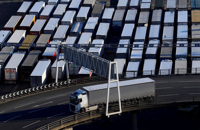 © Reuters. A lorry is driven past dozens of others parked after traveling by ferry between Britain and France at the Port of Dover