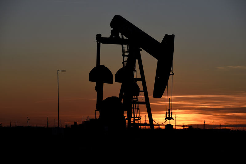 Oil inches higher after U.S. crude stocks drawdown, economic worries weigh