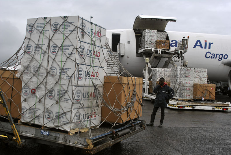 © Reuters. A worker is seen as the first consignment of USAID medical equipment towards the fight against Ebola is offloaded at the Roberts International Airport in Monrovia