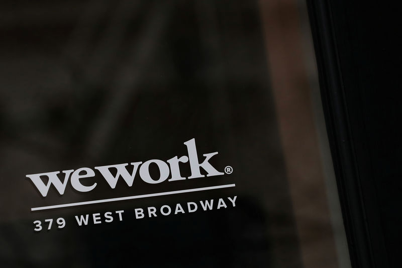 Softbank urges wework to shelve its ipo