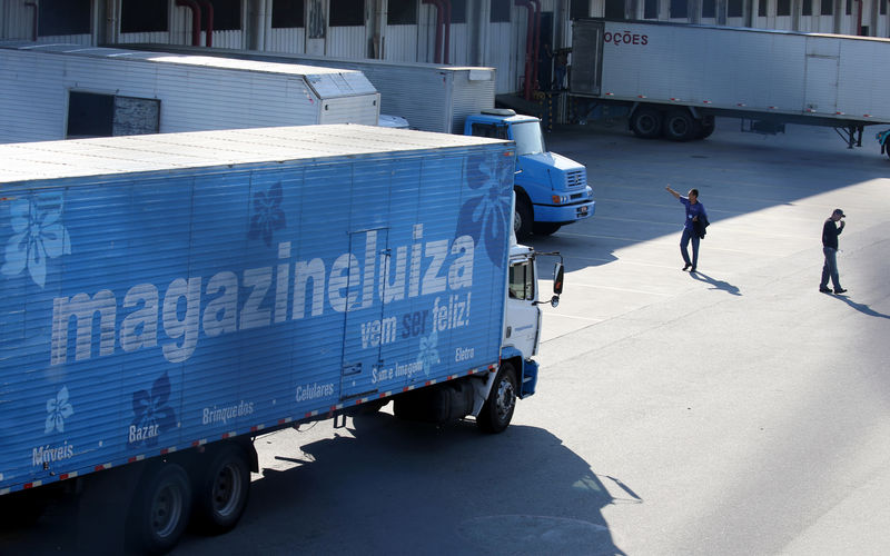 © Reuters. FILE PHOTO: Trucks of retail Magazine Luiza S.A. is seen parked at their logistical center in Louveira