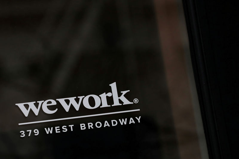 © Reuters. FILE PHOTO: The WeWork logo is displayed on the entrance of a co-working space in New York