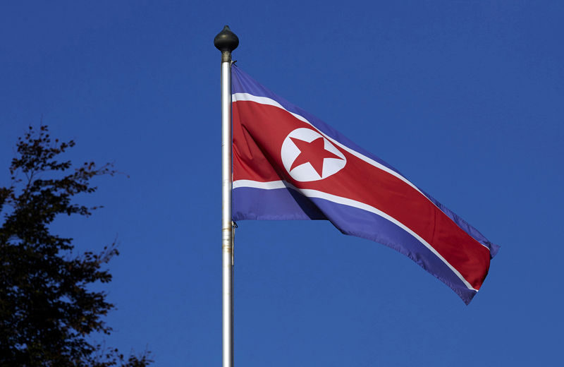 © Reuters. FILE PHOTO - A North Korean flag flies on a mast at the Permanent Mission of North Korea in Geneva