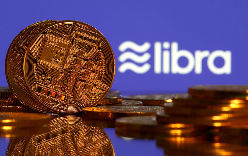 © Reuters. Representations of virtual currency and Libra logo illustration picture