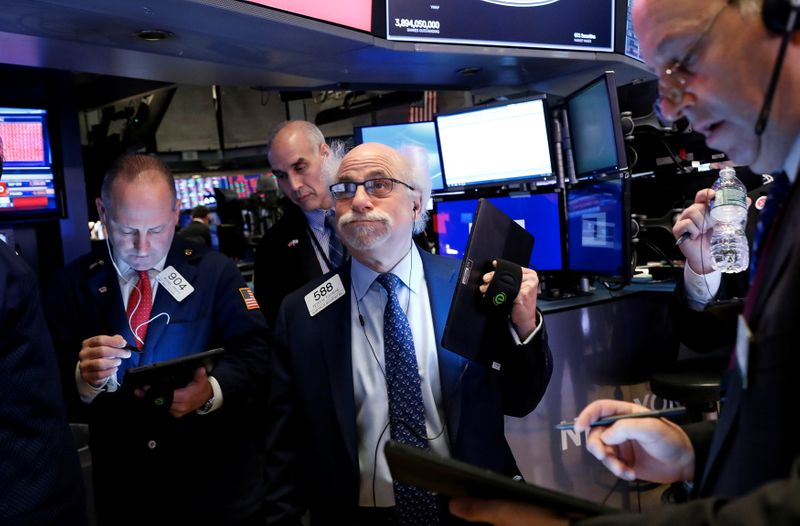 Dow briefly falls over 1,000 points as pandemic worries grow
