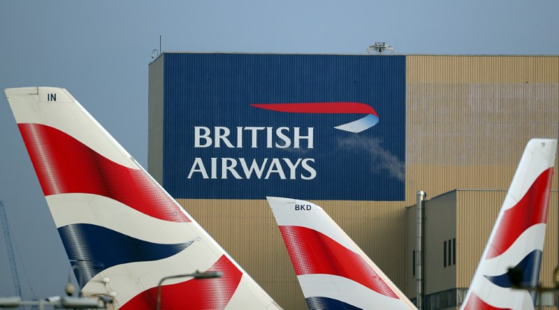 © Reuters. FILE PHOTO: British Airways logos are seen on tail fins at Heathrow Airport in west London