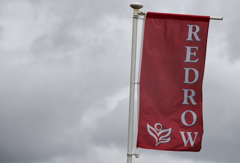 Britain's Redrow gets approved for BoE's financing scheme, furloughs 80% workforce