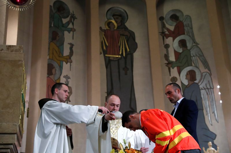 Hungarian triathlon champion who works with COVID-19 patients baptized at Easter