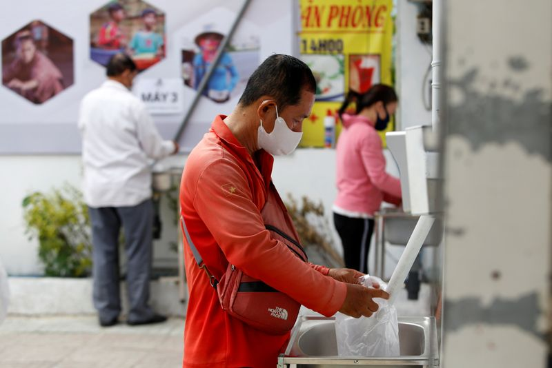 Rice ATM' feeds Vietnam's poor amid virus lockdown By Reuters