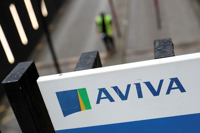 British insurer Aviva halts executive bonuses, pay rises