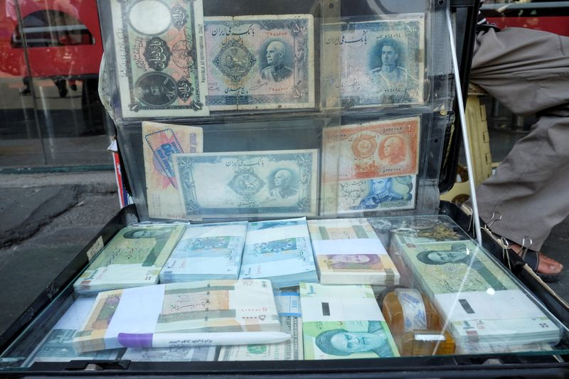Iran's rial hits new low on unofficial market; virus, sanctions weigh