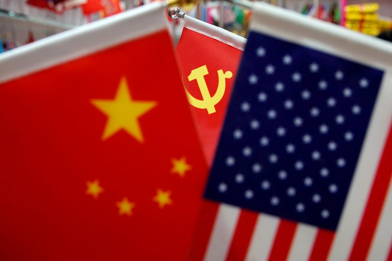 U.S. accuses Chinese nationals of hacking spree for COVID-19 data, defense secrets