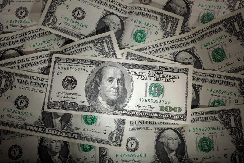 Battered U.S. dollar 'hanging by a thread' as coronavirus cases grow