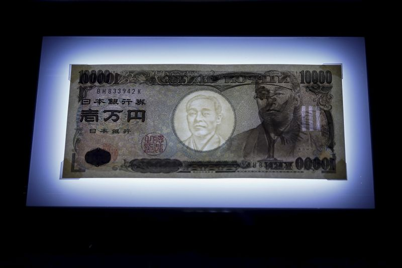 © Reuters. A 10,000 yen bill is seen on display on top of a light panel to make its security features visible at the Currency Museum of the Bank of Japan in Tokyo