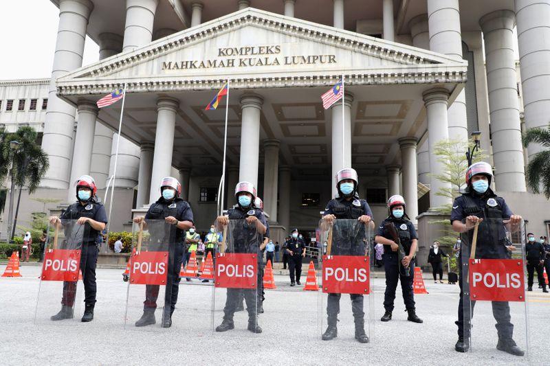 Malaysia's Najib sentenced to over a decade in jail in 1MDB trial