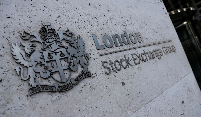 Lloyds, Stan Chart weigh on FTSE 100 amid global stocks rout; AstraZeneca gains