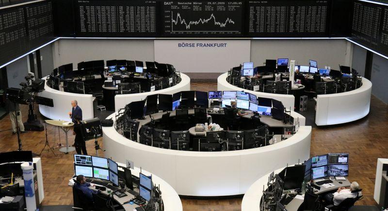 European shares slip as weak earnings offset Fed promise