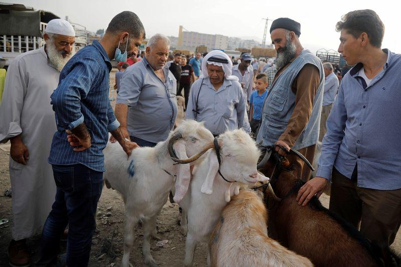In West Bank, Eid sacrifices plummet as Palestinian virus cases soar By Reuters