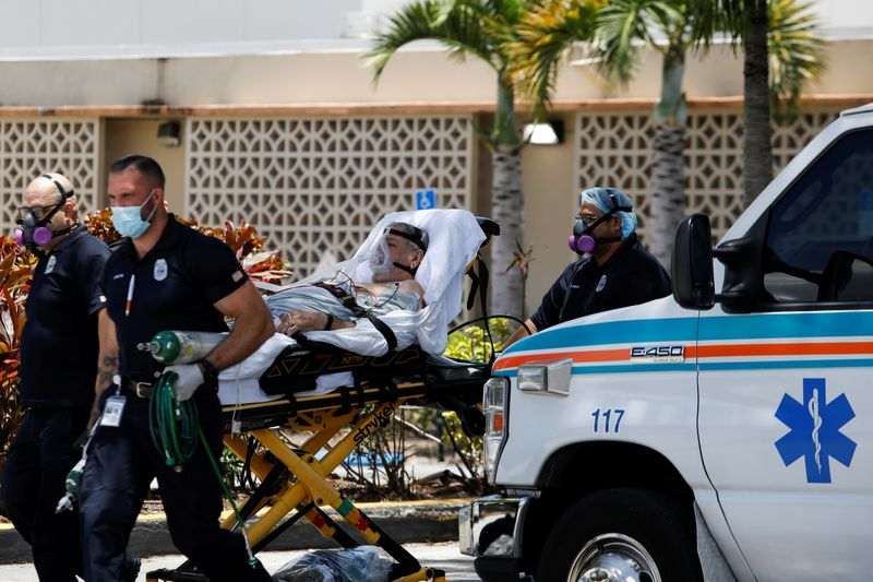 © Reuters. FILE PHOTO: Emergency Medical Technicians (EMT) leave with a patient at Hialeah Hospital where the coronavirus disease (COVID-19) patients are treated