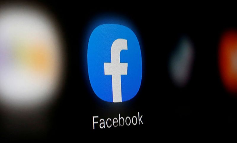 © Reuters. FILE PHOTO: A Facebook logo is displayed on a smartphone in this illustration
