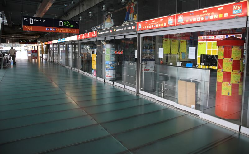 © Reuters. Closed travel agencies at Cologne-Bonn Airport