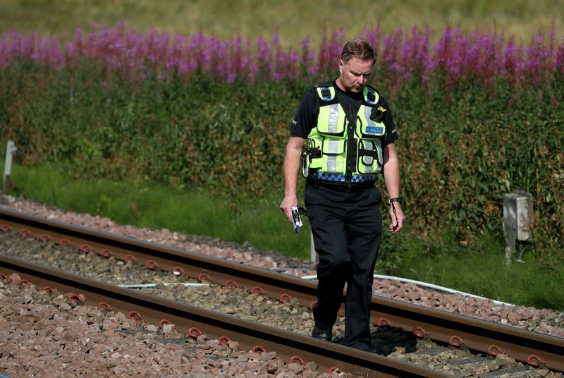 Three people die in Scottish train derailment, carriages piled up