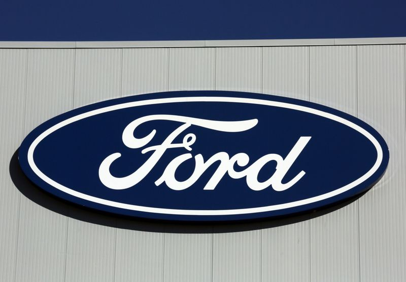 © Reuters. A Ford logo is seen on a wall of the Oakville Assembly Plant as workers with UNIFOR attended a ratification vote nearby
