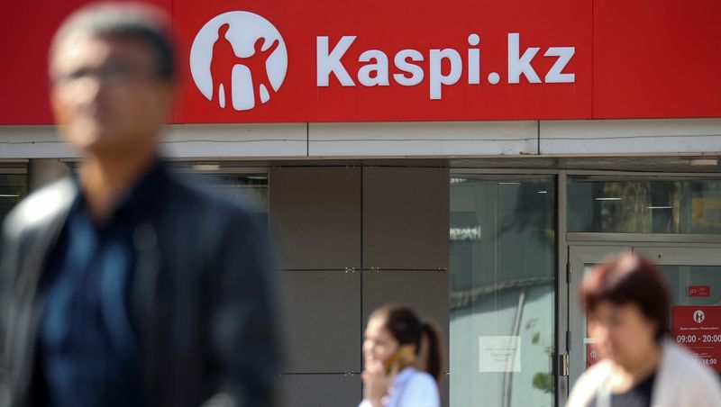 © Reuters. FILE PHOTO: The Kaspi Bank logo in seen at the bank's branch in Almaty