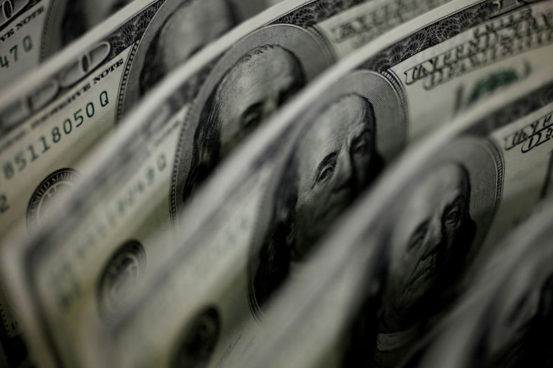 Dollar slides to 2-1/2 month low as Fed rate hike fears subside
