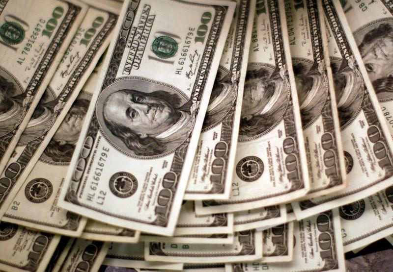Dollar rises on upbeat U.S. manufacturing data