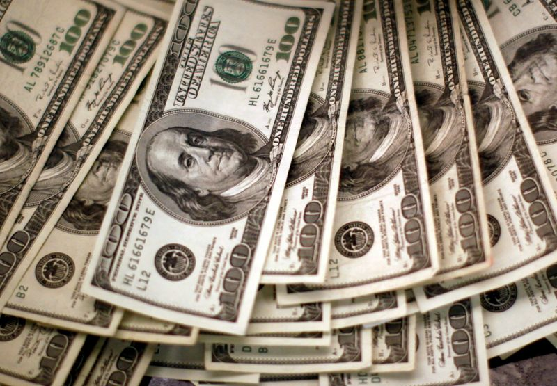 Dollar near 3-month low, weighed by Fed's dovish tilt