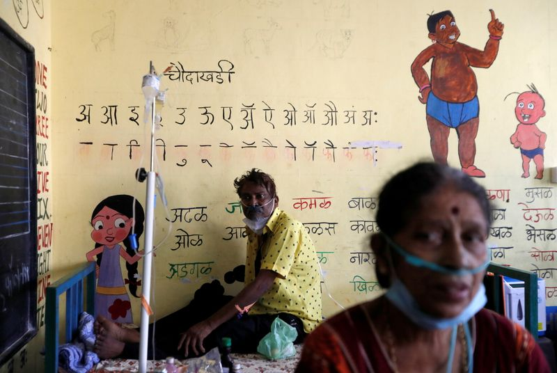 India's coronavirus infections ebb but states struggle for vaccines