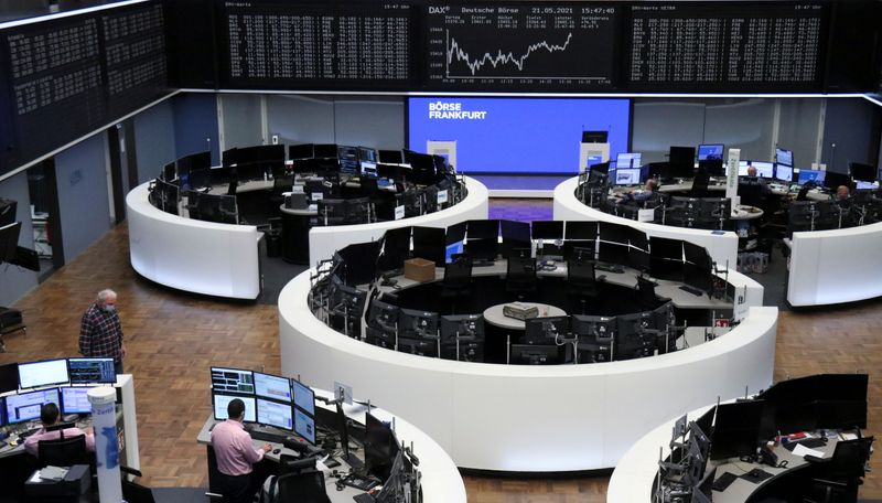 European stocks end below record high as mining losses offset tech rally