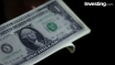 Dollar holds slight gains after  housing data